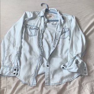 I'm selling a light blue button up flannel